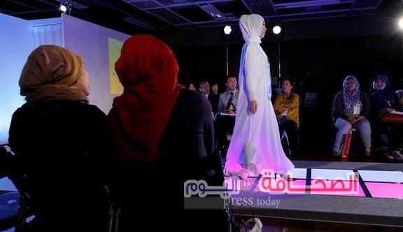 Muslim women look at a model (C) presenting a creation by brand Meem Clothings during Tokyo Modest Fashion Show, Muslim fashion show, at Halal Expo Japan in Tokyo, Japan, November 22, 2016. REUTERS/Toru Hanai