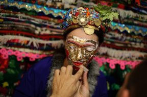 "Bulgarian Muslim bride Lilova gets a special make-up called ""ghelina"" in front of the dowry during her wedding ceremony in the village of Draginovo"